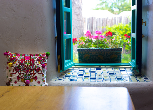 Cut Peonies on Table, Open Turquoise Window with Geraniums