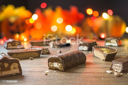 Pieces of chocolate candy bars with light bokeh in the background.