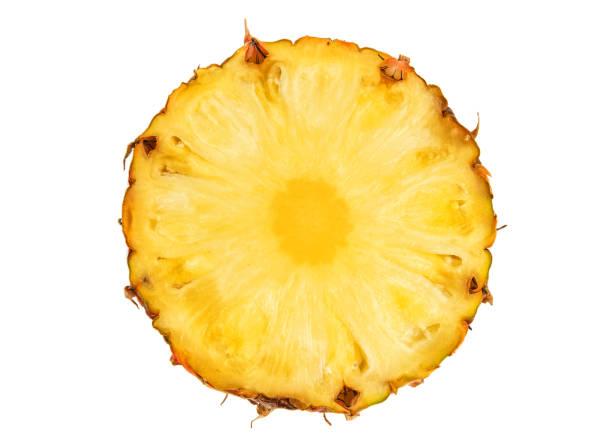 cut pineapple on white stock photo
