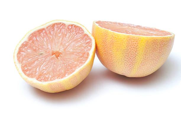 Cut Pink Lemon on White stock photo
