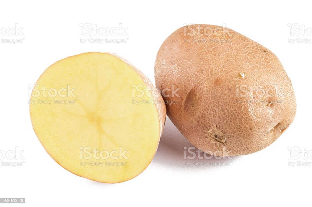 cut raw and whole potatoes royalty-free stock photo