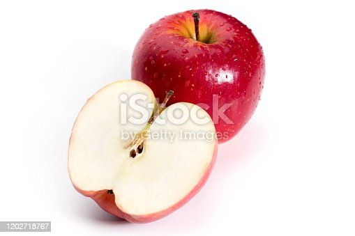 Cut red apple fruits isolated on white background.