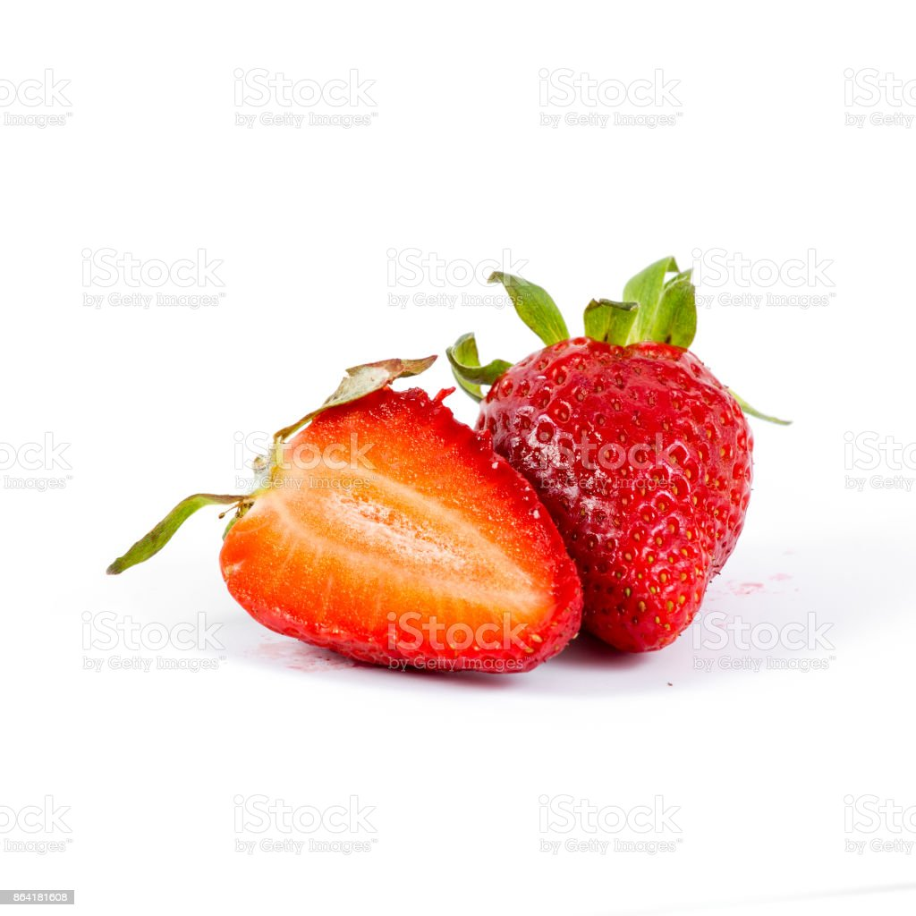 cut strawberries on white background, close-up royalty-free stock photo