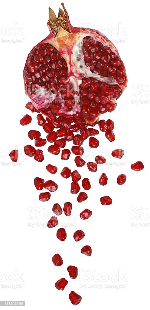 Cut the pomegranate with scattered grain stock photo