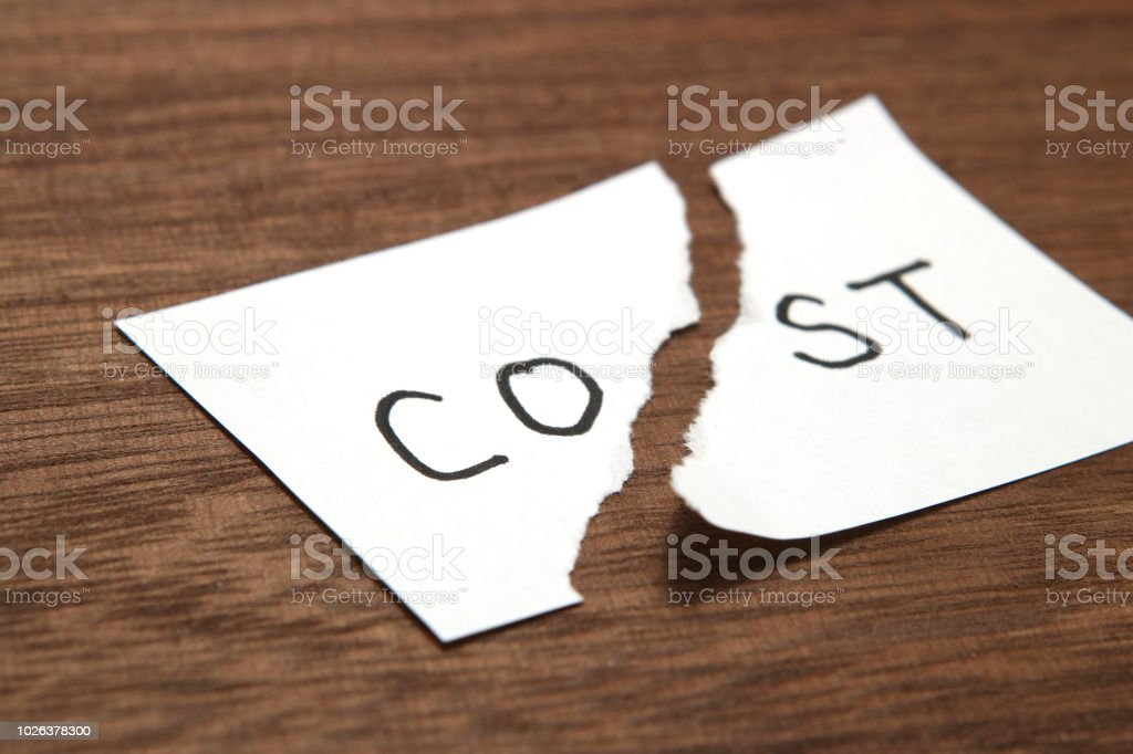 Cut the word cost concept for recession or credit crisis on wood. stock photo