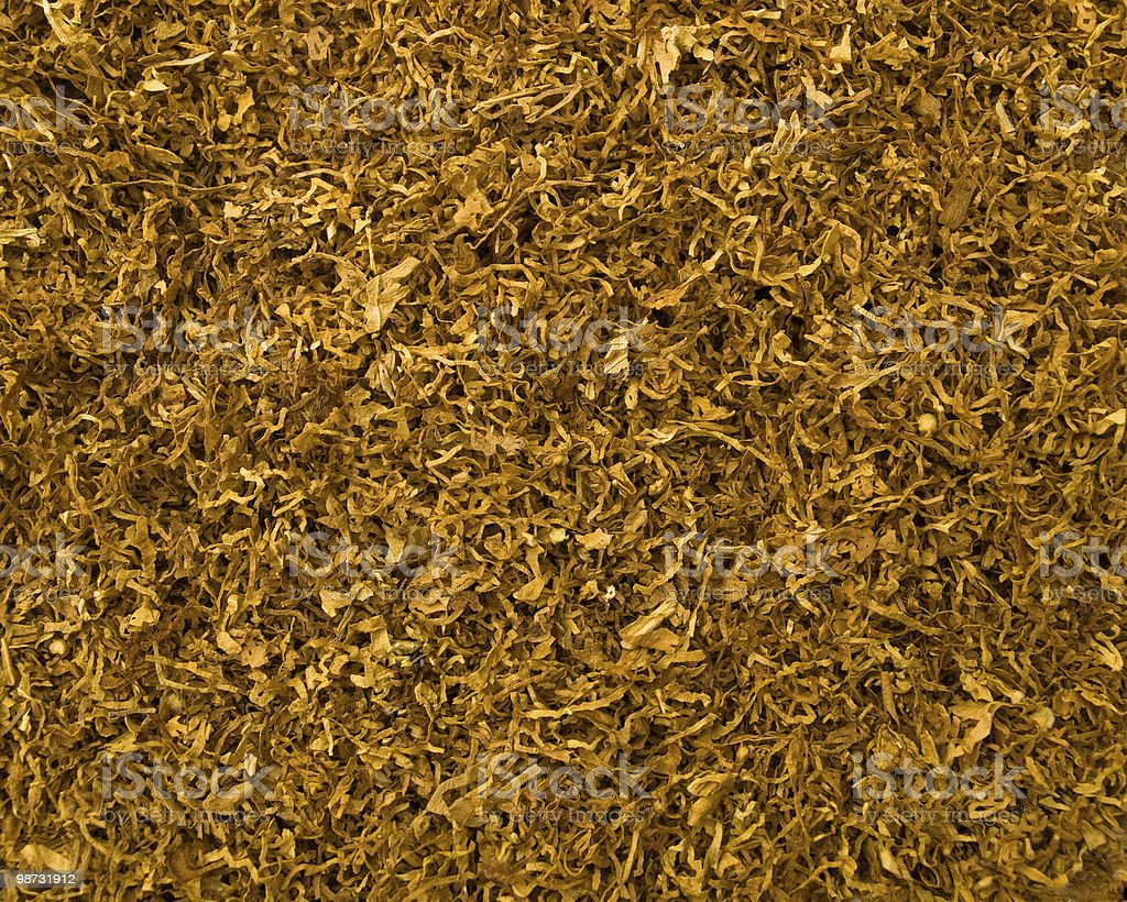 Cut tobacco background royalty-free stock photo