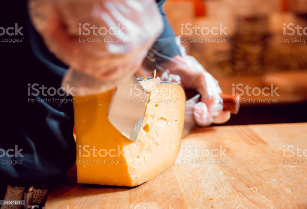 Cut with a knife piece of cheese stock photo