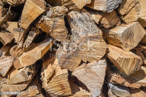 istock Cut wood, firewood for the winter. Cut logs fire wood and ready pieces of wood for heating wood. Lumber industry. Heating season, winter season. Renewable resource of energy. Environmental concept. 1295090553