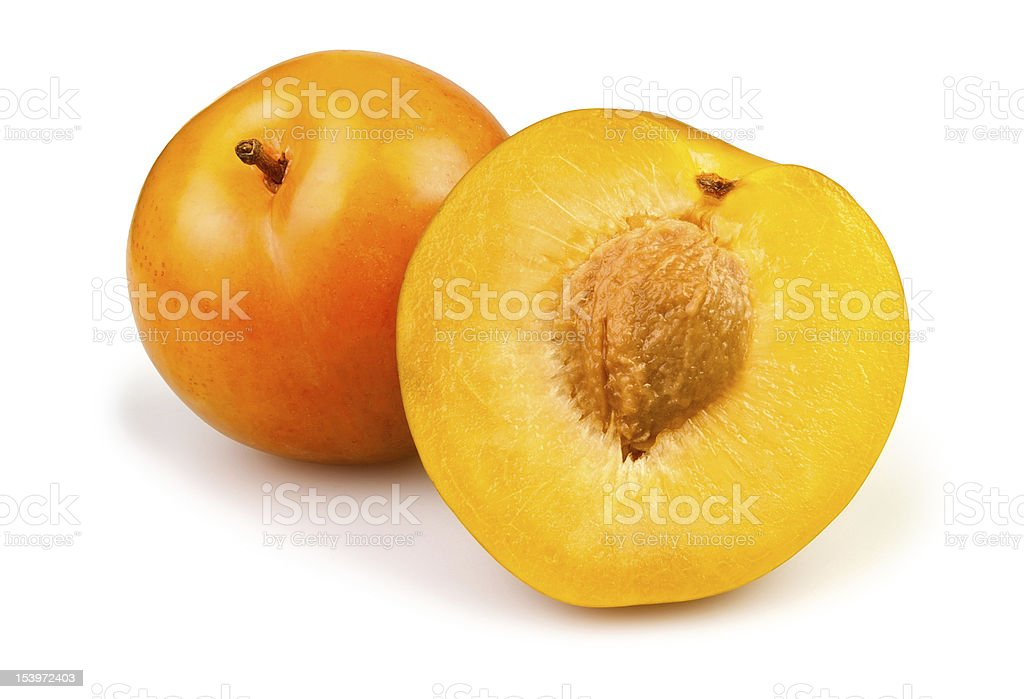 cut yellow plums stock photo
