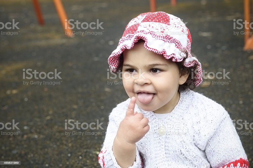 Cute 17 Months Old Baby Girl Sticking Tongue Out royalty-free stock photo
