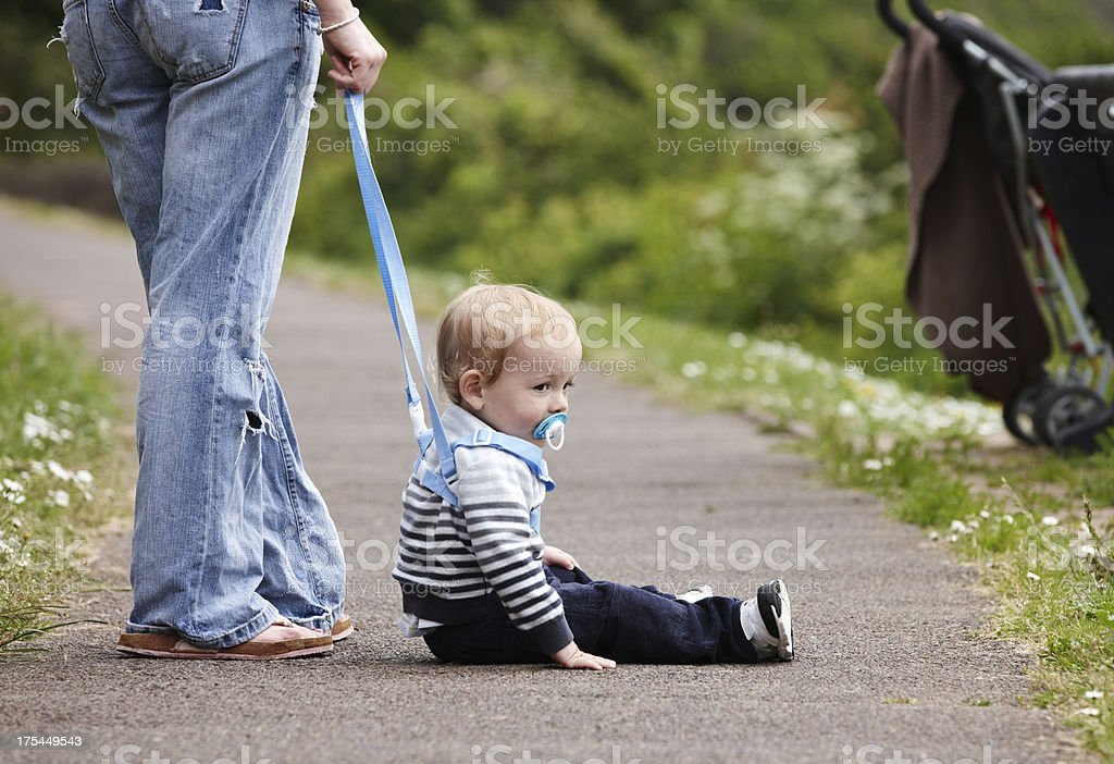 Cute 18 month old boy on footpath stock photo