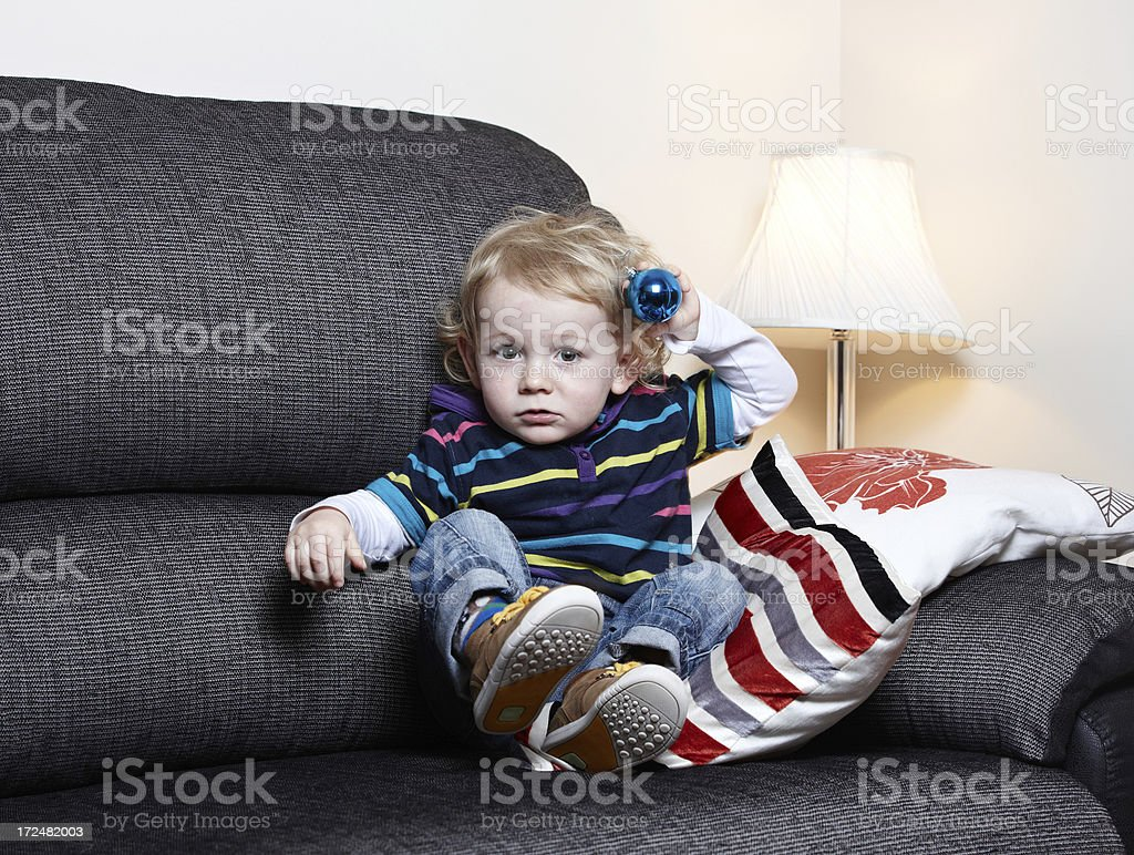 Cute 18 month old boy on sofa royalty-free stock photo