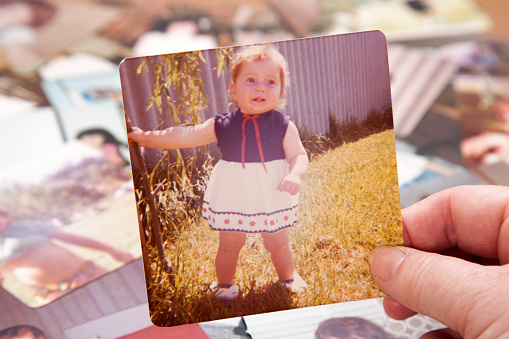 A photograph taken in 1974 of a baby girl standing in the garden, Western Australia. Same model in all background photos.