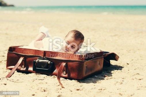 istock cute 2-month old baby lying in vintage case 490993173
