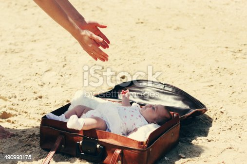 istock cute 2-month old baby lying in vintage case 490993175