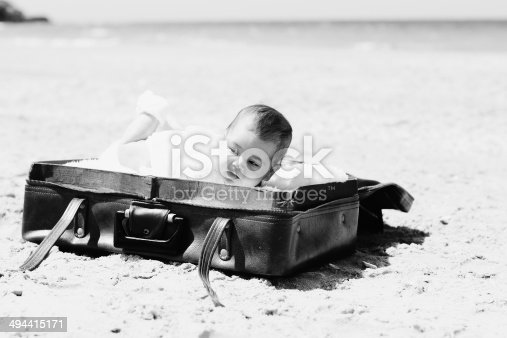 istock cute 2-month old baby lying in vintage case 494415171
