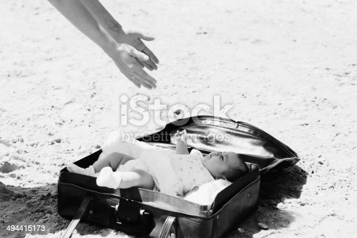 istock cute 2-month old baby lying in vintage case 494415173