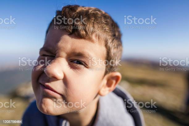 Cute 6 Years Old Boy Making Silly Face Stock Photo - Download Image Now