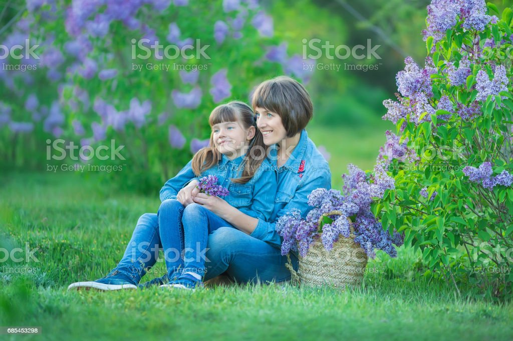 Cute Adorable Beautifull Mother Lady Mom Woman With Brunette Girl Daughter In Meadow Of Lilac Purple