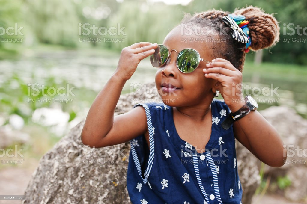 Cute african american baby girl at sunglasses stock photo