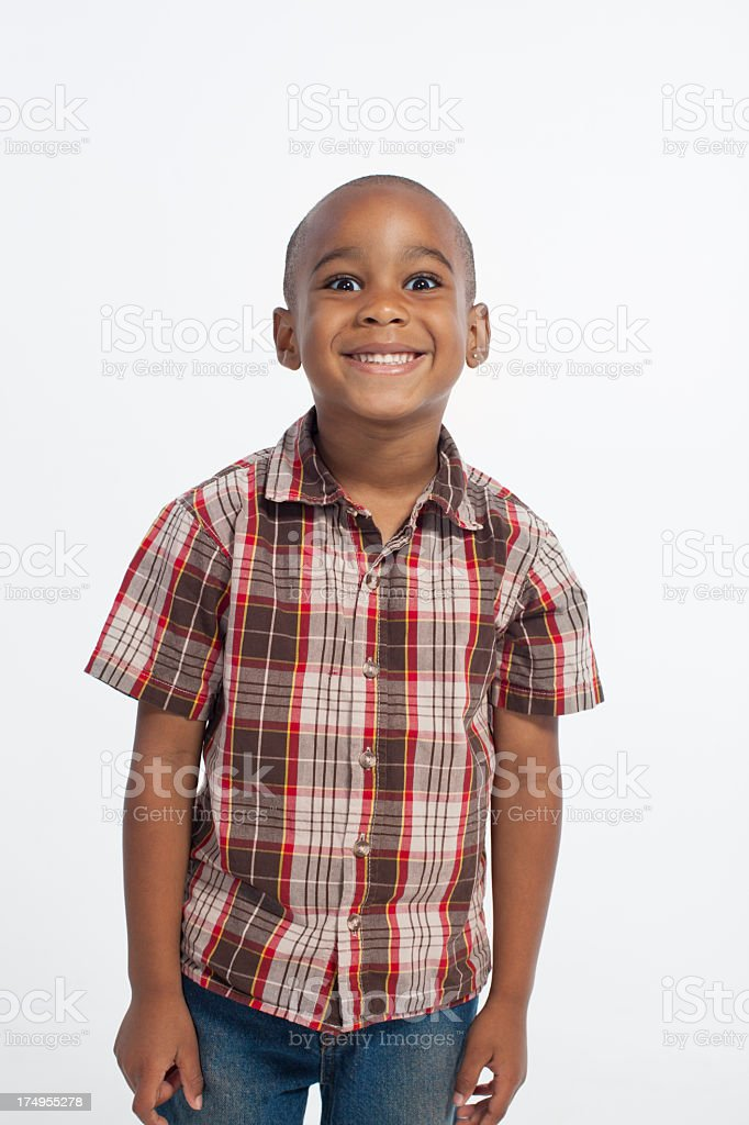 Cute African American boy standing and smiling. stock photo