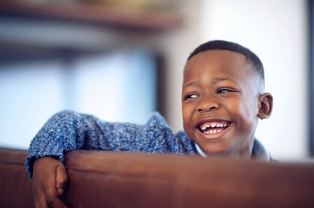 Cute African Boy with a big smile looking away stock photo
