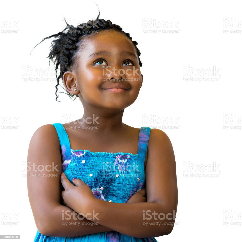 Cute african girl with braids looking up. stock photo