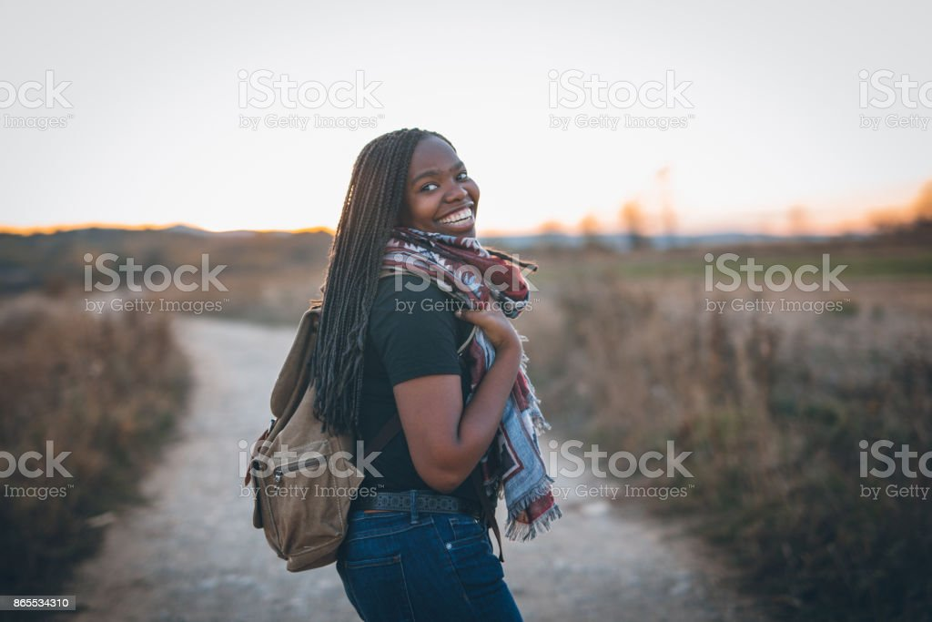 Cute african woman hiking stock photo