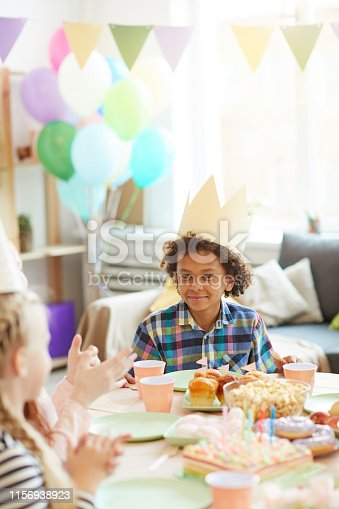 istock Cute African-American Boy at Party 1156938923