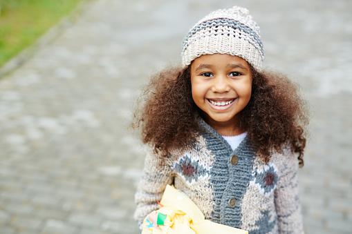 Cute African-American Girl Wearing Knits