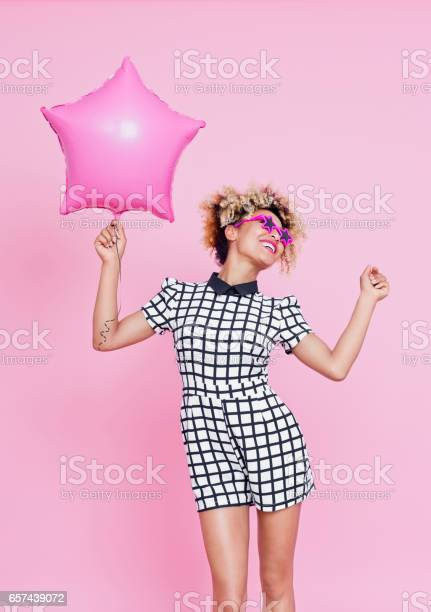 Cute Afro American Woman Holding Pink Balloon Stock Photo - Download Image Now