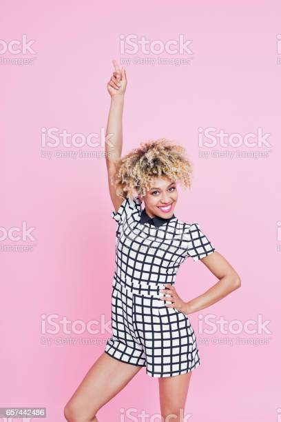 Cute Afro American Young Woman Pointing At Copy Space Stock Photo - Download Image Now