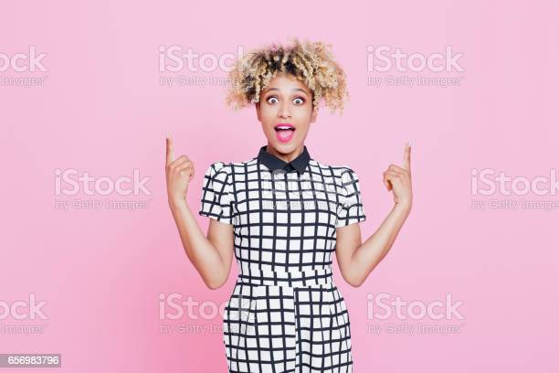 Cute Afro American Young Woman Pointing Stock Photo - Download Image Now