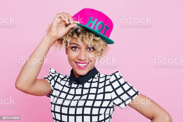 Cute Afro American Young Woman Wearing Baseball Cap Stock Photo - Download Image Now