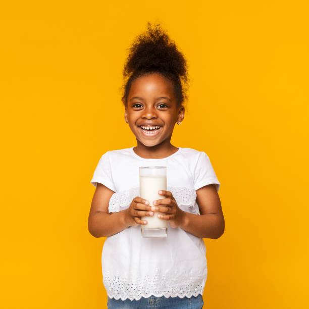 Cute afro girl enjoying glass of milk picture id1174450053?b=1&k=6&m=1174450053&s=612x612&w=0&h=u  fj zfirfifgarnnz7b2yhilkkcxqnpez3vguykja=