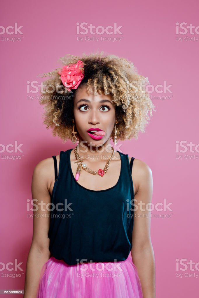 Cute afro woman making funny face stock photo