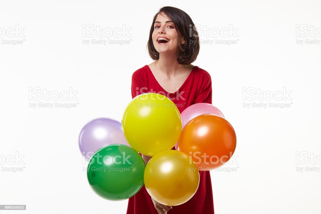 cute and beauty young woman holding brightly colored balloon stock