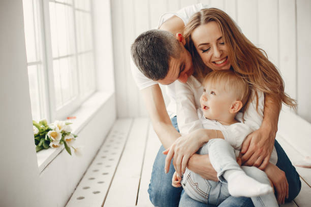 Cute and big family sitting at home stock photo