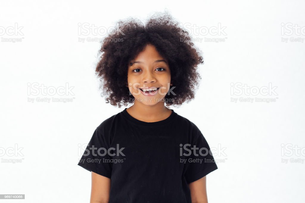 Cute and happy African American kid smiling and laughing isolated over white background stock photo