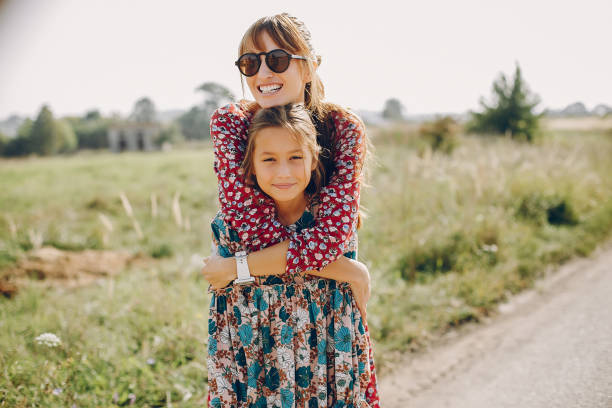 Cute and stylish family in a summer field stock photo