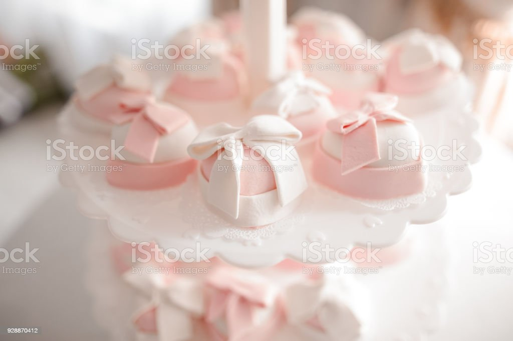 Cute and tasty wedding cakes in white and pink tones stock photo