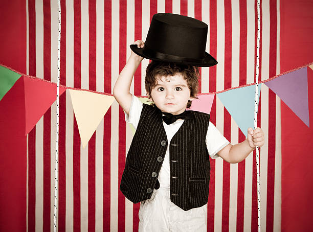 Cute and young boy as ringmaster stock photo