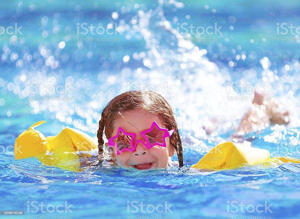 Cute arabic girl in the pool stock photo