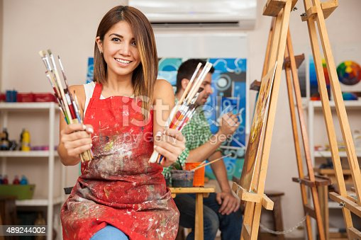 istock Cute art student loves to paint 489244002