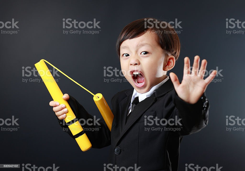 Cute asia child Kung Fu stock photo