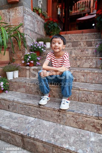 Cute asia children in the hutong