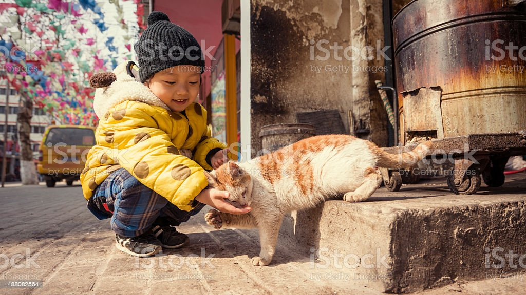 Cute asia children in the hutong stock photo