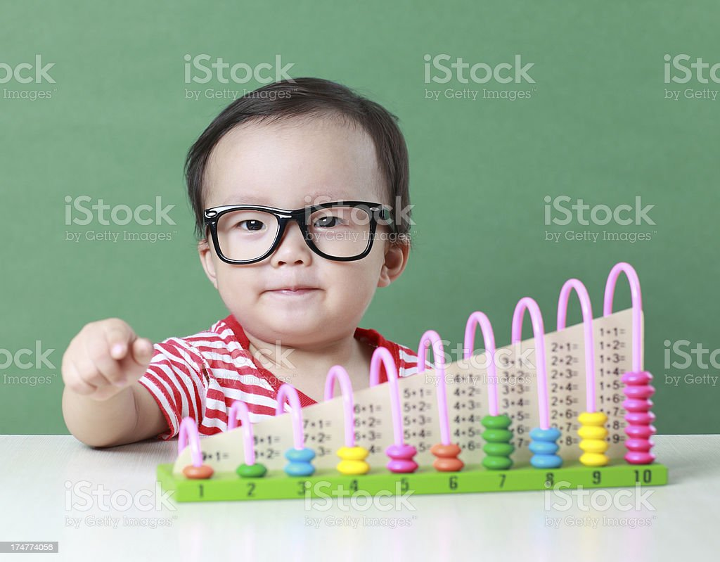 Cute Asian baby do arithmetic royalty-free stock photo