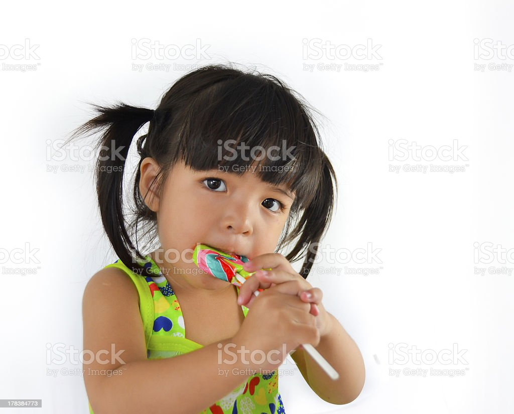 cute asian baby girl and big lollipop royalty-free stock photo