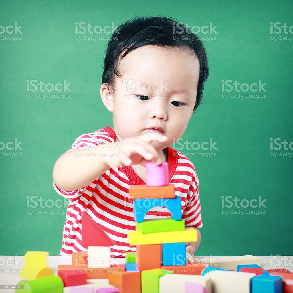 Cute Asian baby playing with blocks royalty-free stock photo